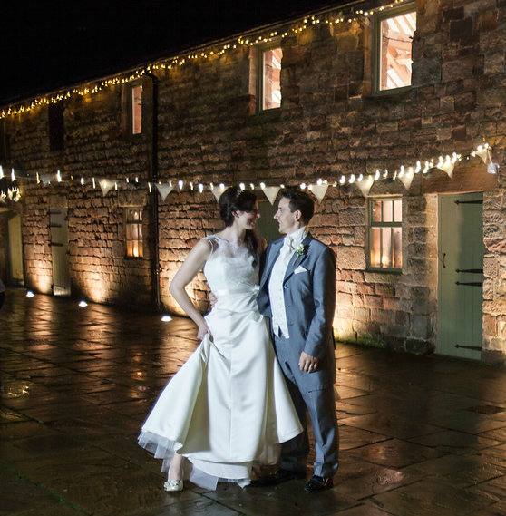 Real bride laura in Augusta Jones - Bride & Groom bunting & lights image