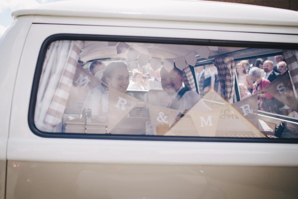 Real Bride Olivia wears Jesus Peiro - Bride & Groom in camper van colour