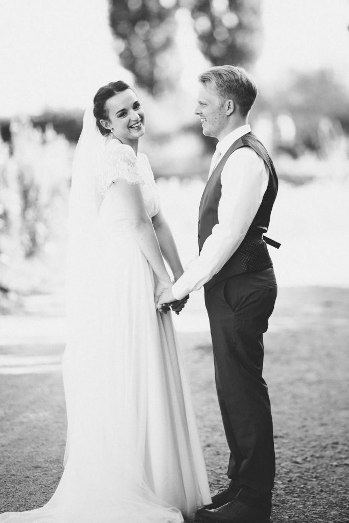 Real Bride Olivia wears Jesus Peiro -- Bride & Groom holding hands in black & white