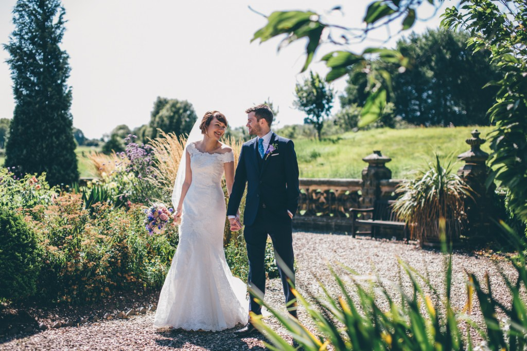 Real Bride Clare wears Jesus Peiro Dress 6005 - Bride & Groom in gardens
